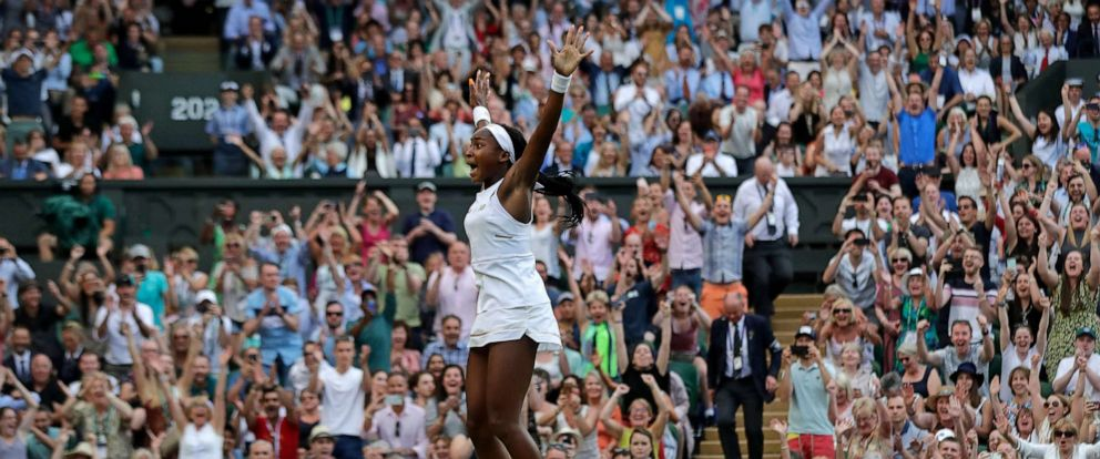 """PHOTO: United States Cori """"Coco"""" Gauff celebrates after beating Slovenias Polona Hercog in a Womens singles match during day five of the Wimbledon Tennis Championships in London, July 5, 2019."""