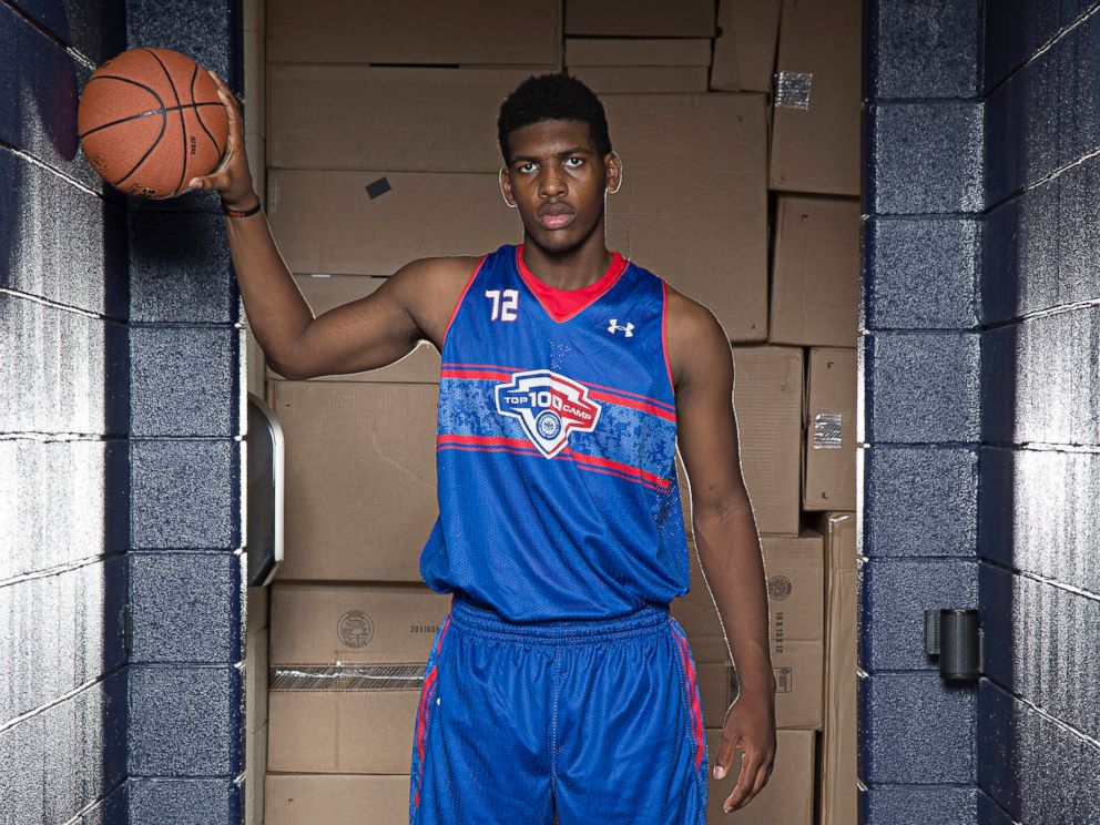 PHOTO: Cody Riley #72 in blue poses for a portrait during the National Basketball Players Association Top 100 Camp, June 19, 2014, at John Paul Jones Arena in Charlottesville, Virginia.