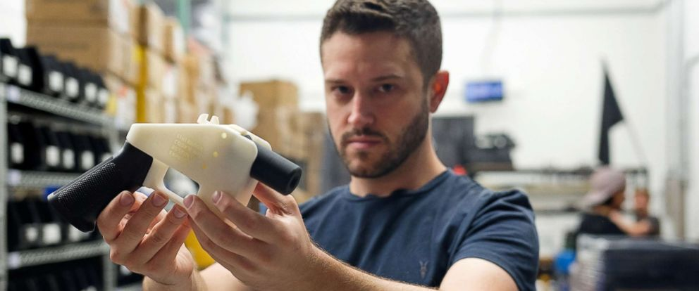 "PHOTO: Cody Wilson, owner of Defense Distributed company, holds a 3D printed gun, called the ""Liberator,"" in his factory in Austin, Texas, Aug. 1, 2018."