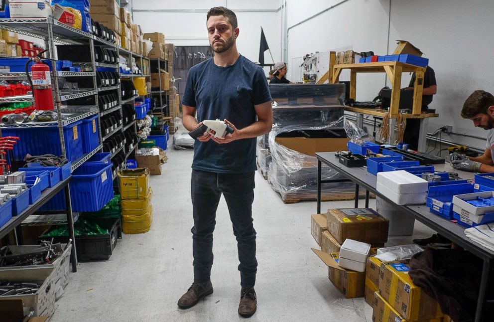 PHOTO: Cody Wilson, owner of Defense Distributed company, holds a 3D printed gun, called the Liberator, in his factory in Austin, Texas, Aug. 1, 2018.