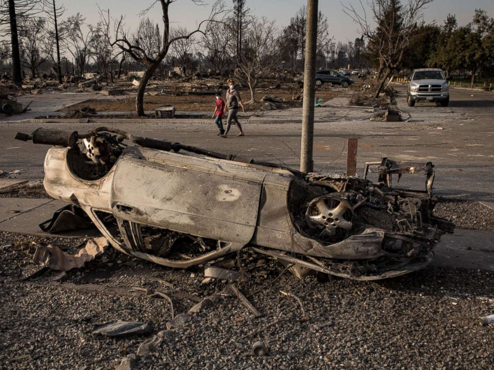PHOTO: A burned-out car, likely knocked upside down by a gasoline explosion, sits in the ruins of the Coffey Park neighborhood of Santa Rosa, Calif., Oct. 11, 2017.