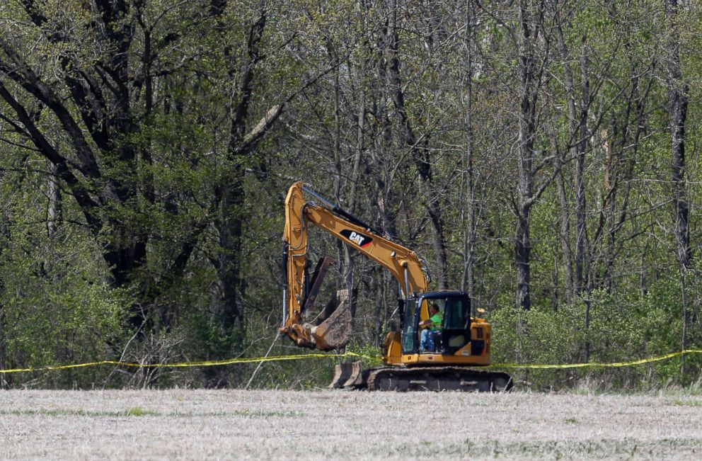 PHOTO: An excavator moves to a rural wooded area in Macomb Township, Mich., May 8, 2018. Authorities are searching w miles from downtown for the remains of a 12-year-old girl last seen in 1979.