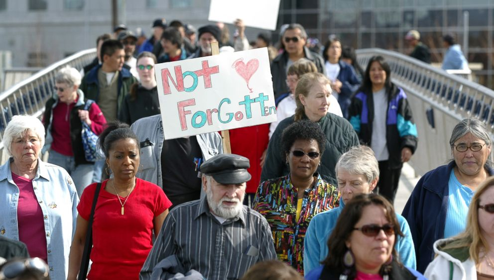 PHOTO: Friends and family of the victims of unsolved homicides march during an annual event to raise awareness of the murders held on the anniversary of the day that Sophie Sergies body was found, in Fairbanks, Alaska, April 26, 2009.