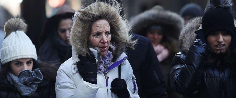 PHOTO: People walk through a frigid Manhattan on Dec. 28, 2017 in New York.