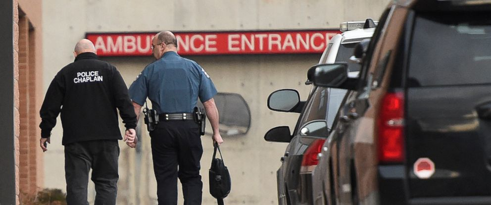 PHOTO: A police chaplain heads to the ambulance entrance at UCHealth Memorial Hospital Central following a shooting in Colorado Springs, Colo., Feb. 5, 2018.