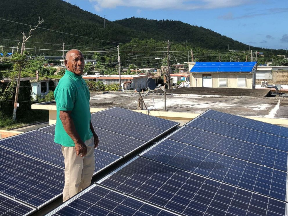 Community leader Angel Colon with the solar panels atop a building in Daguao, Puerto Rico. how being prepared for hurricane season starts with solar power in one puerto rico town How being prepared for hurricane season starts with solar power in one Puerto Rico town colon solar pr abc mo 20180530 hpMain 4x3 992