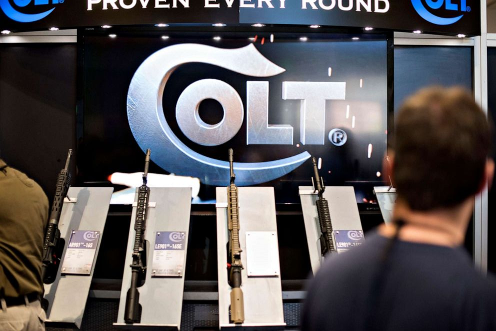 PHOTO:Rifles sit on display in the Colts Manufacturing Co. booth on the exhibition floor of the 144th National Rifle Association (NRA) Annual Meetings and Exhibits in Nashville, Tenn., April 11, 2015.