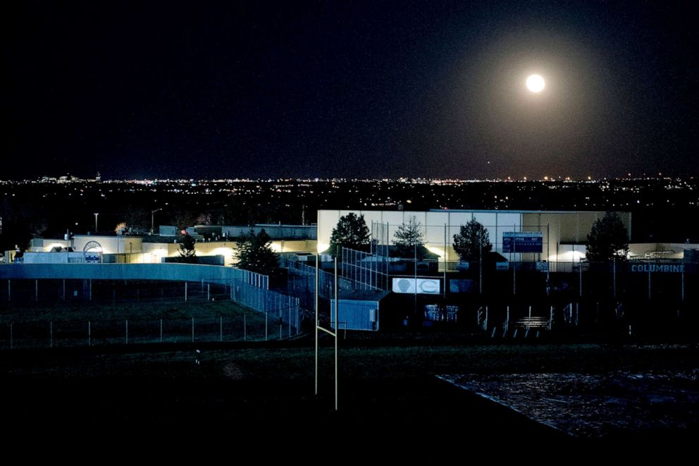 PHOTO: A full moon rises over Columbine High School in Littleton, Colo., April 19, 2019.