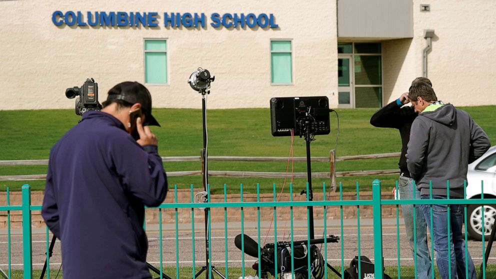 Members of the media gather outside Columbine High School after some Denver area schools closed during a police search for an armed woman
