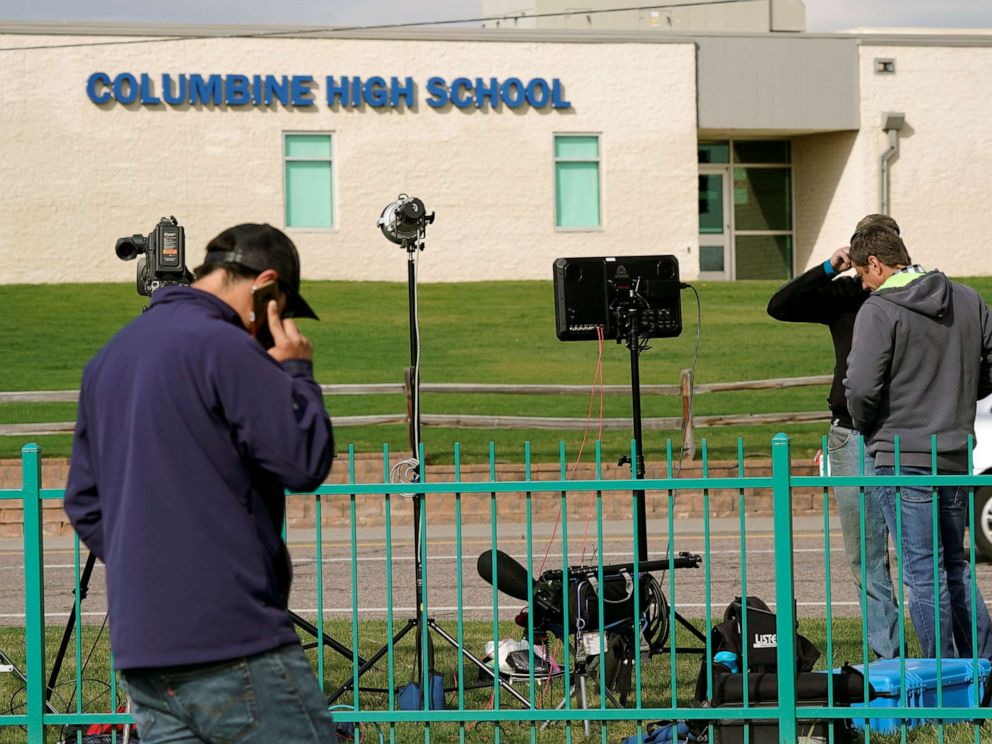 PHOTO: Members of the media gather outside Columbine High School after some Denver area schools closed during a police search for an armed woman infatuated with the Columbine massacre, in Littleton, Colo., April 17, 2019.