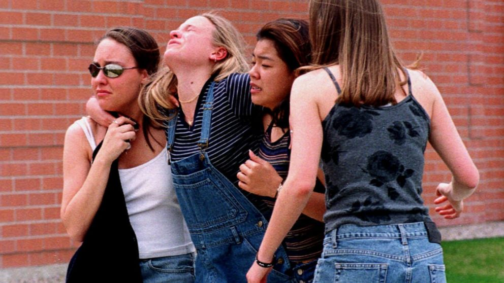Young women head to a location near Columbine High School where students and faculty members were evacuated after two gunmen went on a shooting rampage in the school in the southwest Denver suburb of Littleton, Colo., April 20, 1999.