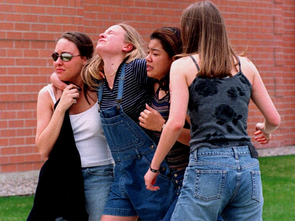 PHOTO: Young women head to a location near Columbine High School where students and faculty members were evacuated after two gunmen went on a shooting rampage in the school in the southwest Denver suburb of Littleton, Colo., April 20, 1999.