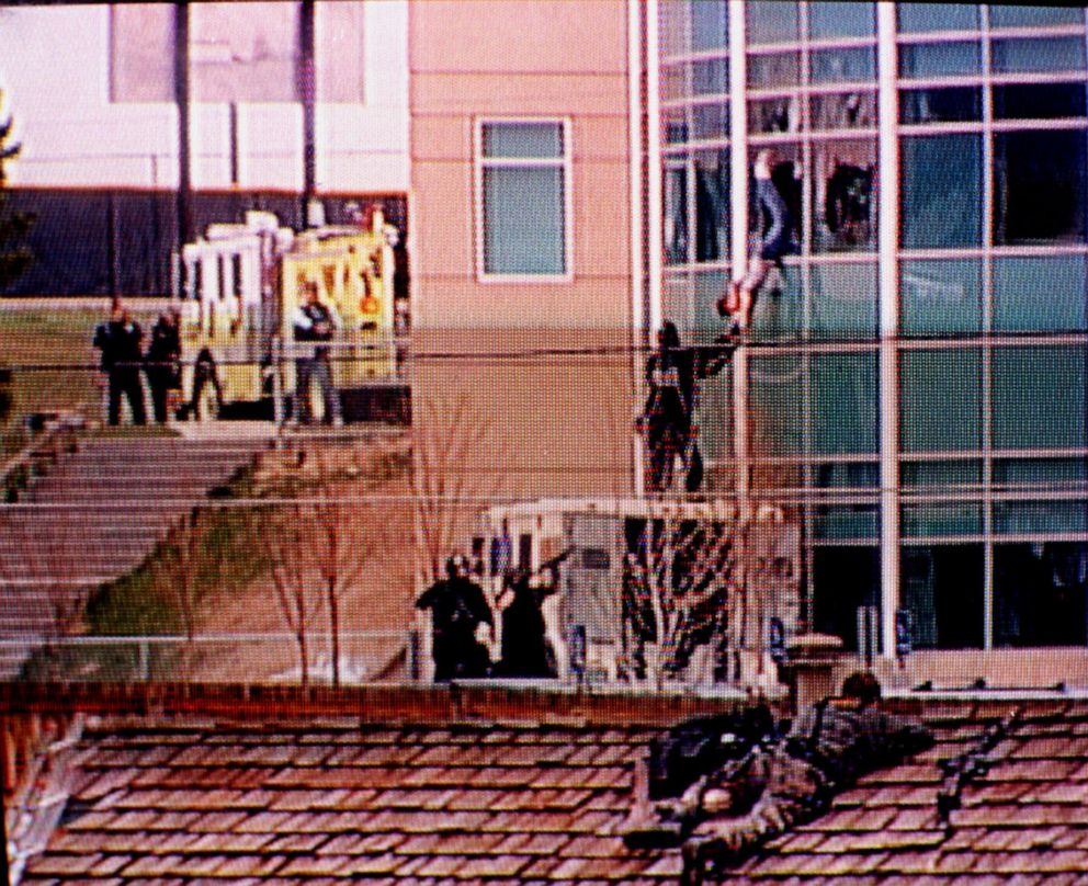 In this image from television, a Columbine High School student is rescued by emergency personnel during the shooting spree at the school in the southwest Denver suburb of Littleton, Colo., April 20, 1999.