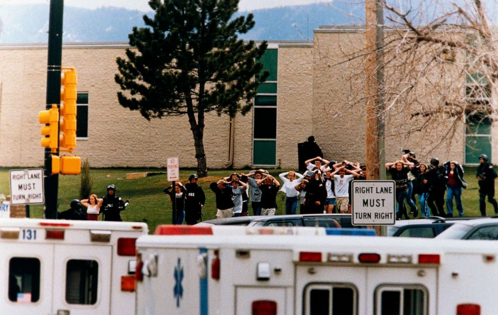 PHOTO: Students run out of the Columbine High School as two gunmen went on a shooting spree in Columbine High School in Littleton, Colo., April 20, 1999.