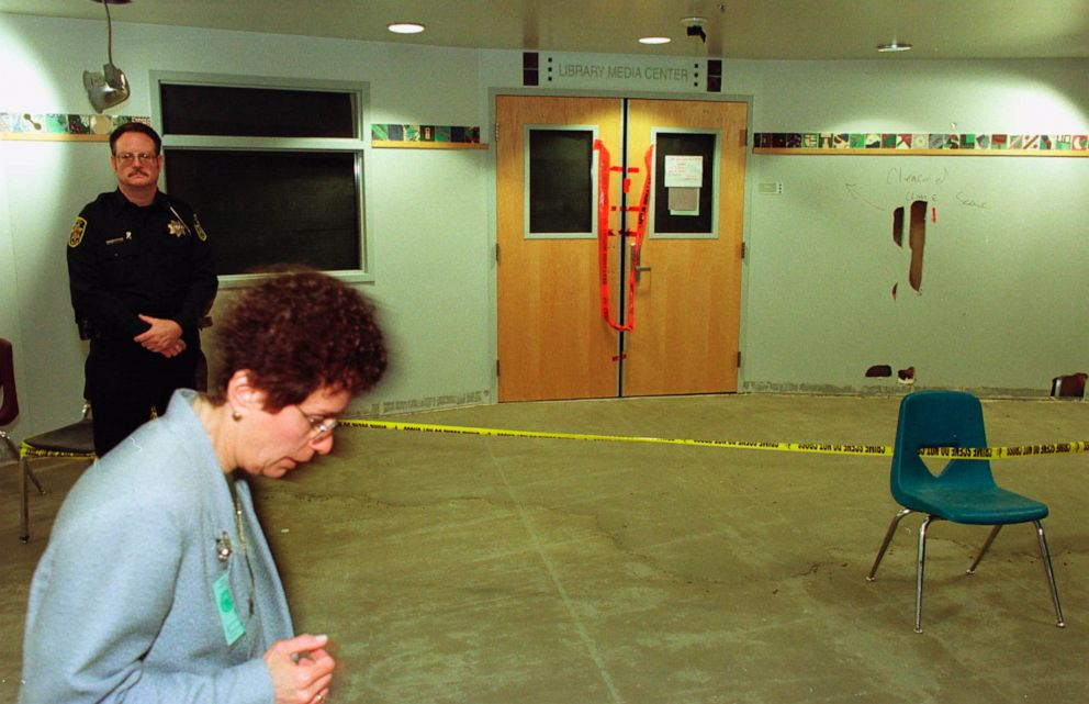 PHOTO: A security officer stands guard at the entrance to the Columbine High School library on June 15, 1999, nearly two months after the shooting.