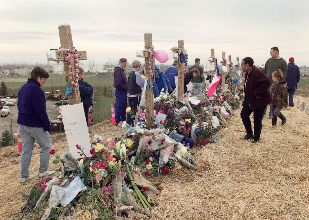 PHOTO: Mourners visit a memorial of crosses on a hill overlooking Columbine High School in Littleton, Colo., on May 1, 1999.