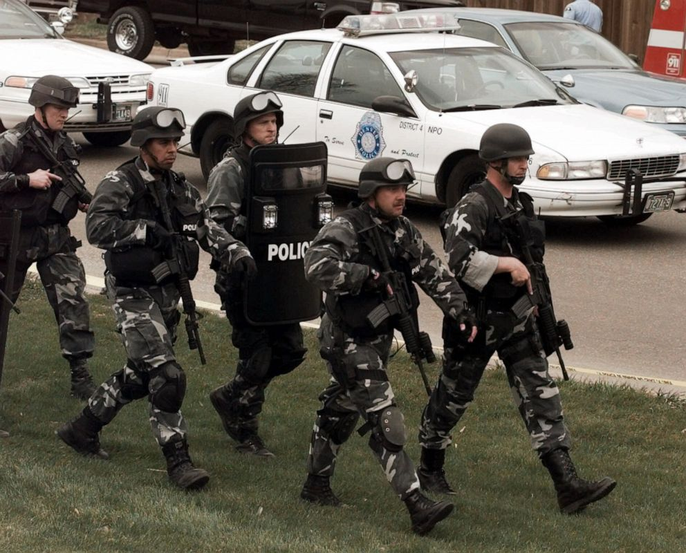 PHOTO: Members of a police SWAT march to Columbine High School in Littleton, Colo., April 20, 1999.