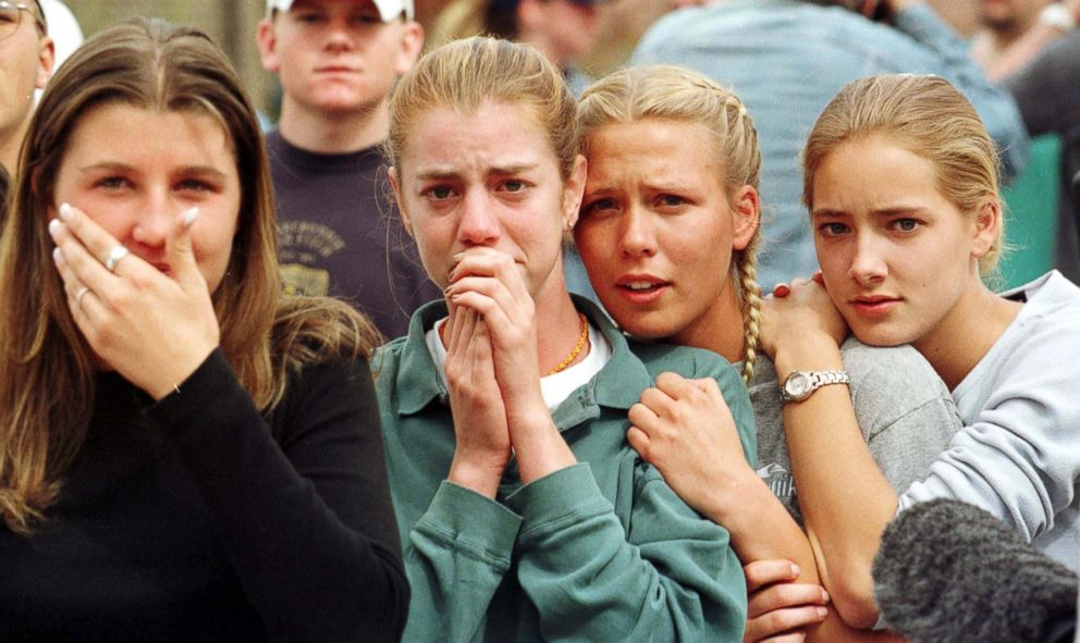 PHOTO: Students from Columbine High School in Littleton, Colo., watch as the last of their fellow students are evacuated from the school building April 20, 1999 following a shooting spree at the school.