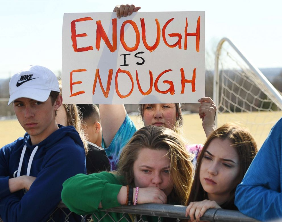 PHOTO: Leah Zundel, 15, a student at Columbine High School, holds a sign that reads Enough is Enough as she and other students walked out of classes in protest of gun violence for 17 minutes, March 14, 2018 in Littleton, Colo.