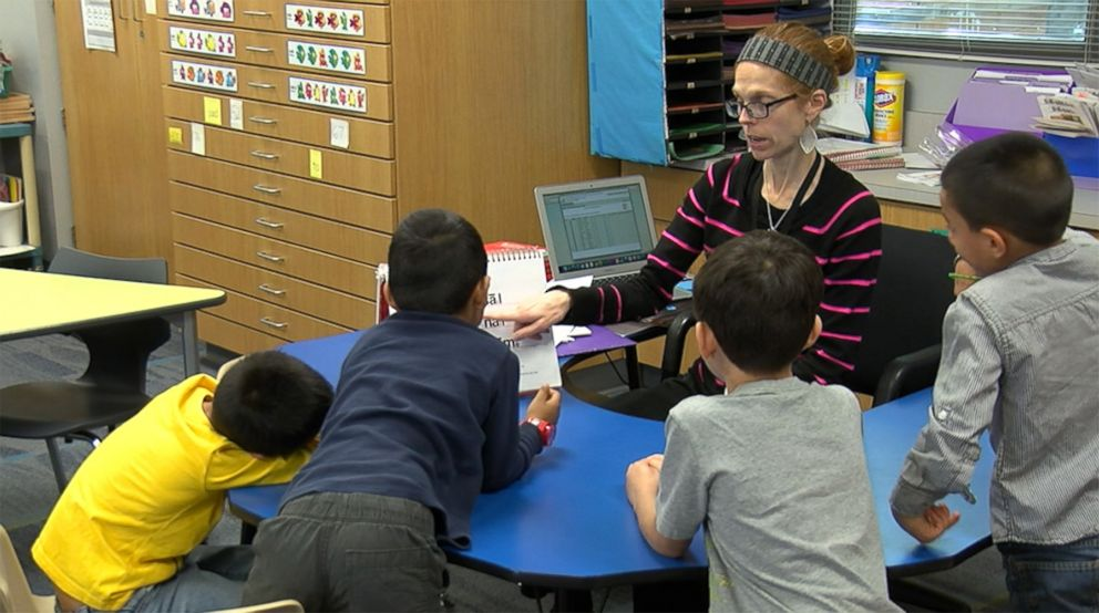 PHOTO: Michelle Porter, 37, a Columbine High School shooting survivor, teaches a lesson to her students at McGregor Primary School in Texas.