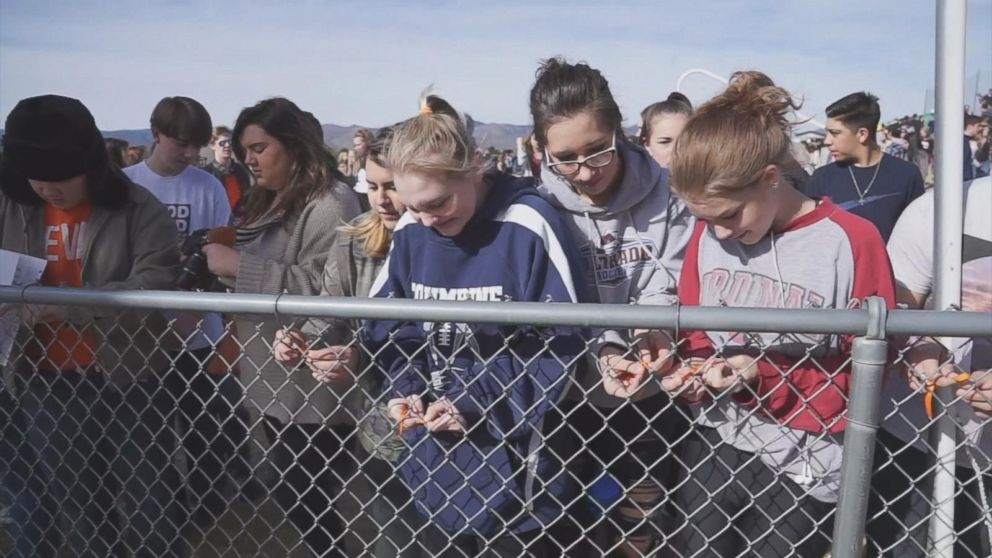 PHOTO: Columbine High School students walk out of classes to demand stricter gun laws as part of a nationwide protest on March 14, 2018, in Littleton, Colo., one month after the Florida high school shootings.
