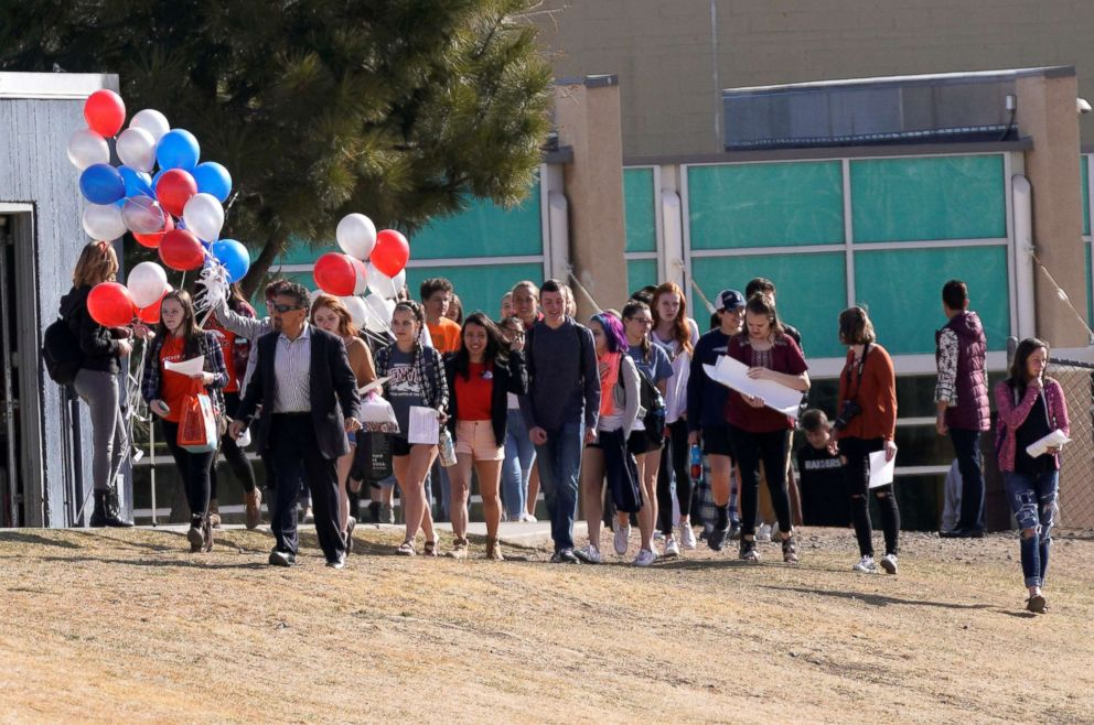 PHOTO: Columbine High School students, led by former Columbine principal Frank DeAngelis, walk outside during a National School Walkout to honor the 17 students and staff killed at Marjory Stoneman Douglas High School, Littleton, Colo., on March 14, 2018.