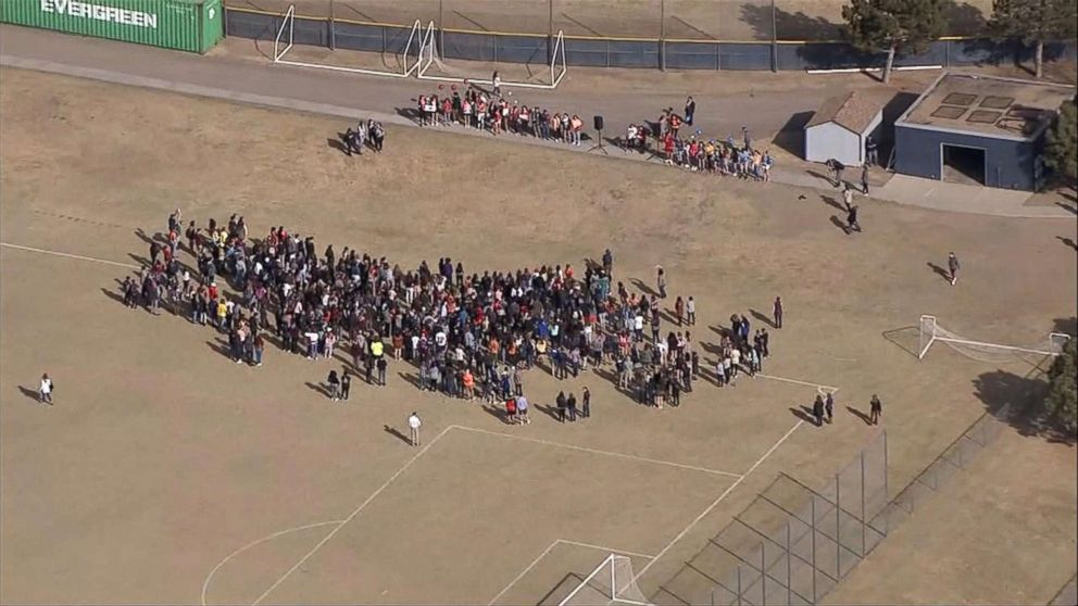 PHOTO: Students at Columbine High school in Littleton, Colo., walk out of classes to demand stricter gun laws as part of a nationwide protest on March 14, 2018, one month after the Parkland high school shootings in Florida.