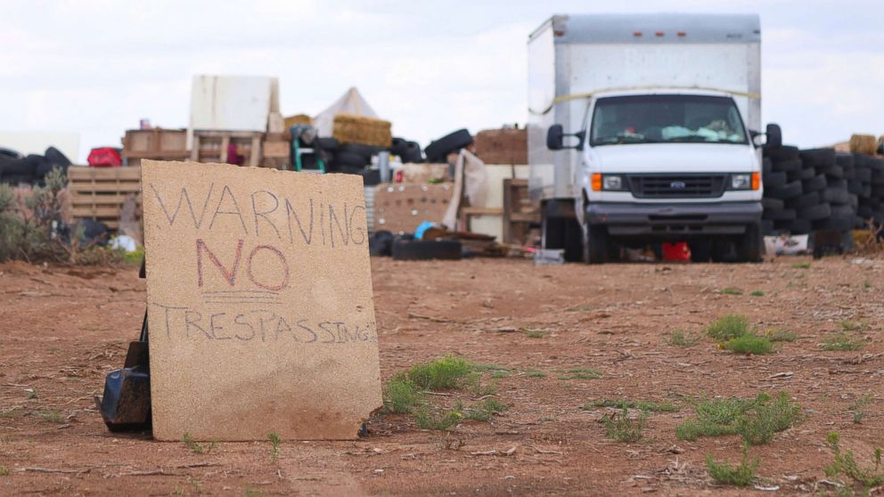 "A ""no trespassing"" sign outside of the location where people camped near Amalia, N.M., Aug. 5, 2018. Three women believed to be the mothers of 11 children found hungry and living in a filthy makeshift compound have been arrested, following the weekend arrests of two men."