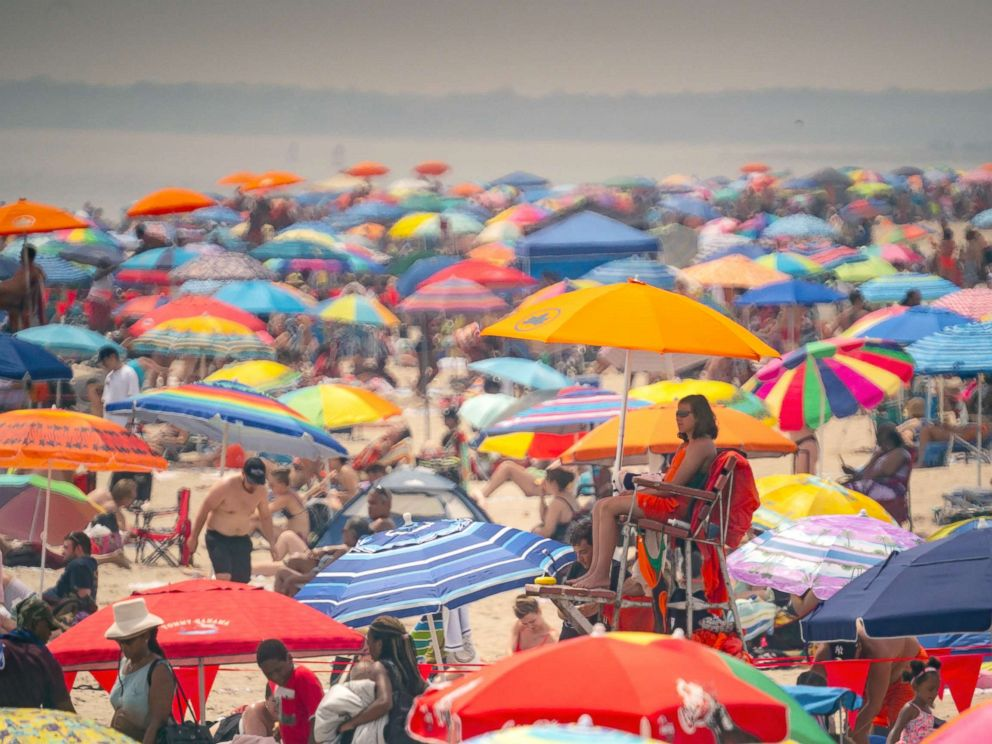 PHOTO: Thousands of beach goers literally pack the beach trying to beat the oppressive heat and escape to Coney Island, in Brooklyn, N.Y., July 1, 2018.
