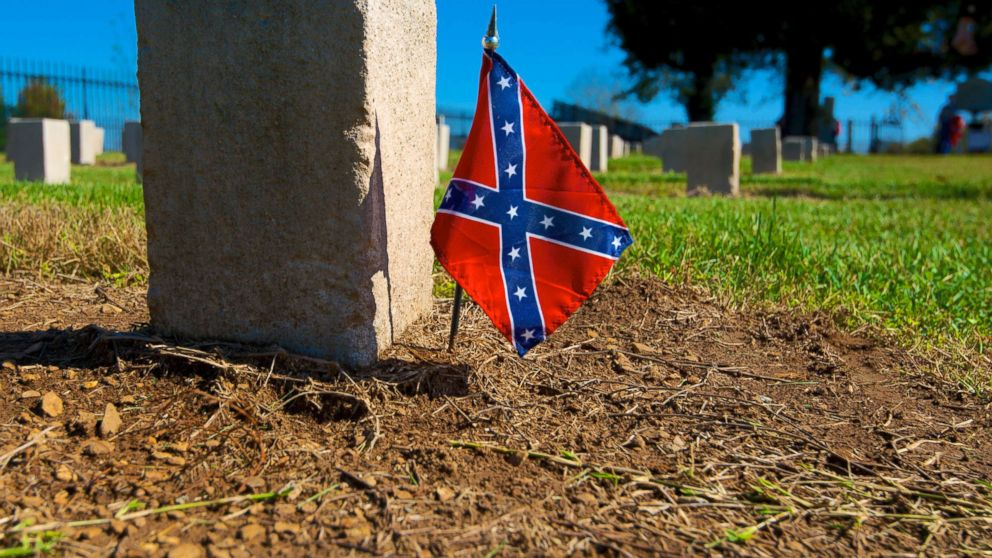 A confederate flag is put next to a gravestone in a cemetery, in this undated file photo.