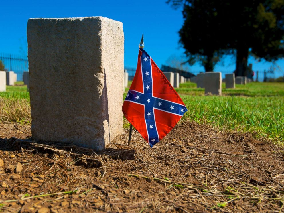 PHOTO: A confederate flag is put next to a gravestone in a cemetery, in this undated file photo.
