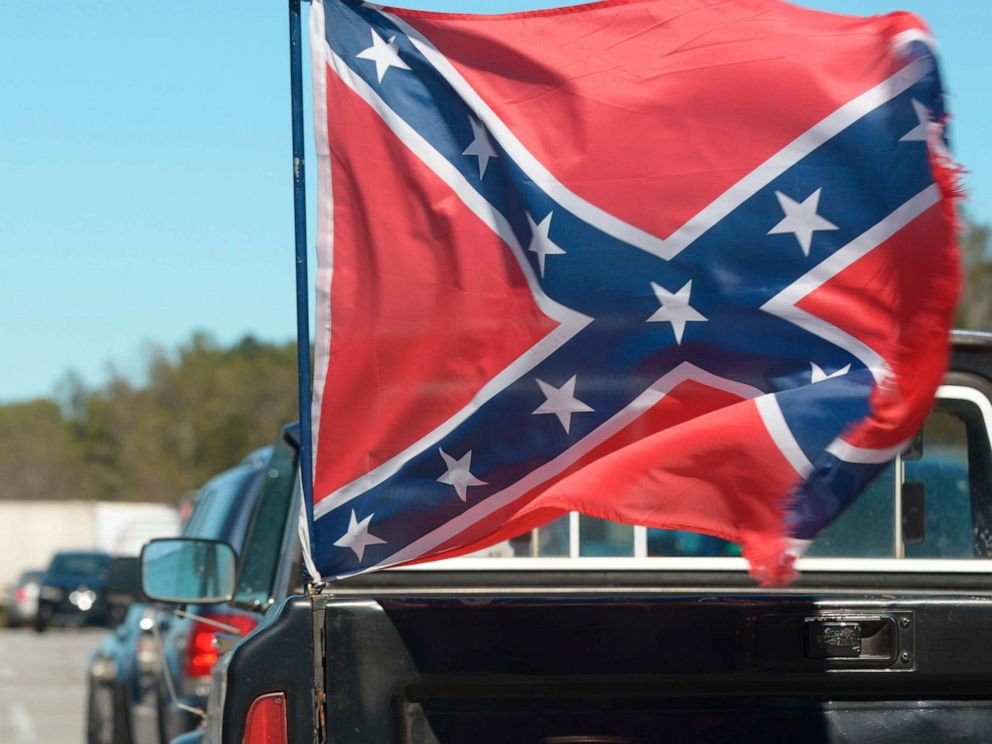 PHOTO: A Confederate flag, attached to the back of a pick up truck, waves in the winds in Georgia.