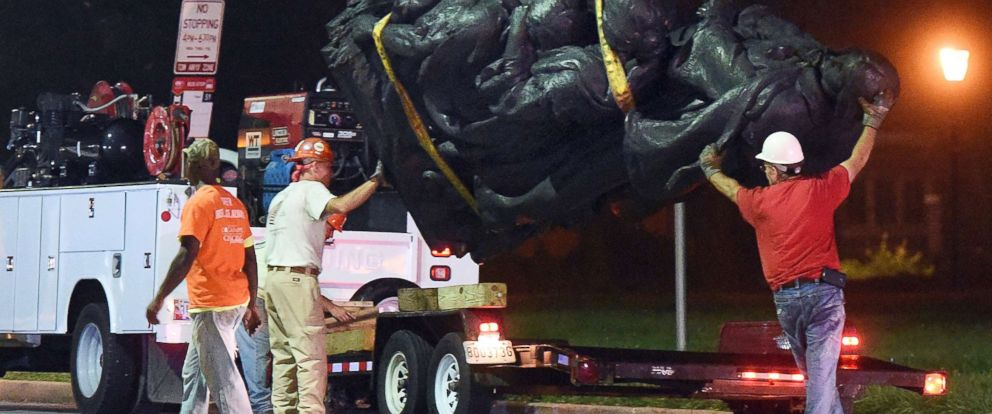 PHOTO: Workers remove a monument dedicated to the Confederate Women of Maryland, Aug. 16, 2017, after it was taken down in Baltimore.