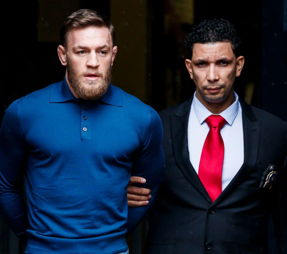 PHOTO: Mixed martial arts fighter Conor McGregor is escorted from a New York City police precinct after he turned himself and was arrested and charged with three counts of assault and one count of criminal mischief in Brooklyn, N.Y., April 6, 2018.