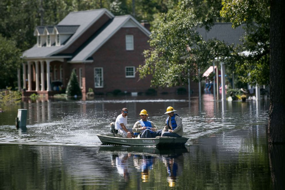 PHOTO: People navigate floodwaters caused by Hurricane Florence near the Waccamaw River, Sept. 23, 2018, in Conway, South Carolina.