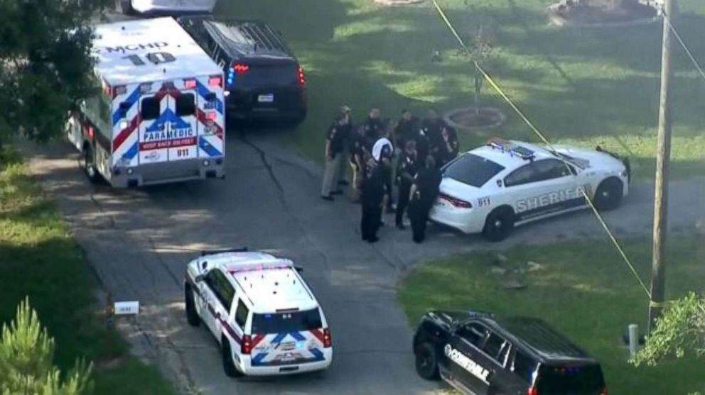 Police group outside a home where a Harris County Sheriffs Office deputy was shot and killed allegedly by his brother, a fellow officer, on Friday, May 25, 2018.