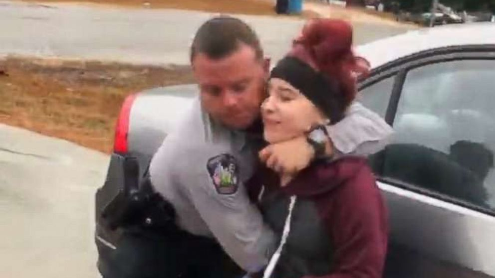 A Filmed Her Sister Being Tackled To The Ground By A Police Officer After Her