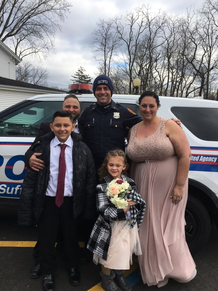 PHOTO: Joseph DeMichele and Feliece Terwilliger were given a ride to their wedding by Suffolk County, N.Y., police after getting into a car accident on the way to the ceremony on Saturday, Dec. 22, 2018.