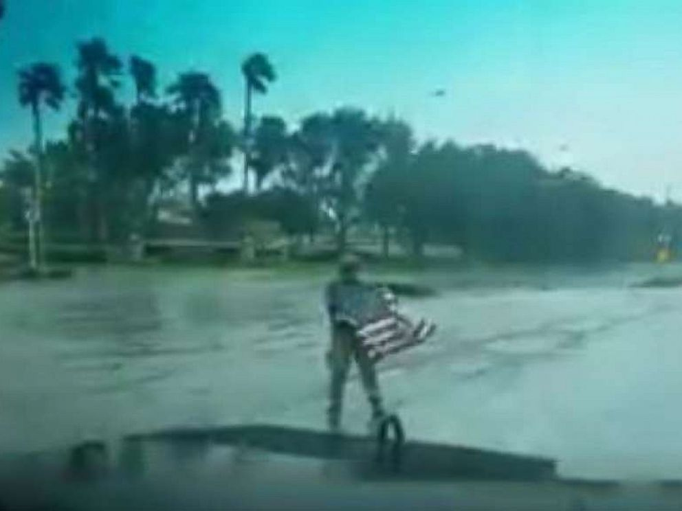 PHOTO: First responder Joseph Schiavo picks up a fallen flag while patrolling in Coral Springs, Florida, after Hurricane Irma hit the area, Sept. 10, 2017.