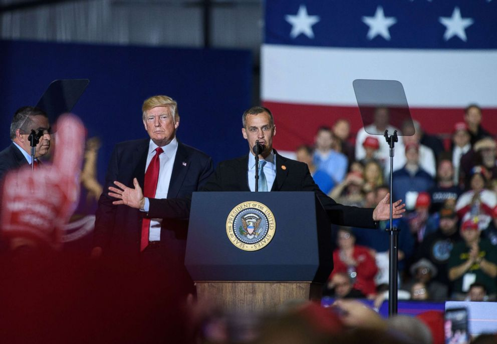 PHOTO: Former Trump Campaign manager Corey Lewandowski speaks as US President Donald Trump looks on during a rally at Total Sports Park in Washington, Michigan, April 28, 2018.