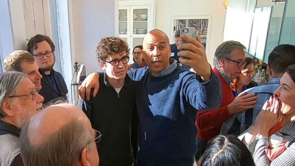 Sen. Cory Booker, D-N.J., poses for a photo at a house party in Nashua, N.H., as he tested the waters for a presidential run on Saturday, Dec. 8, 2018.