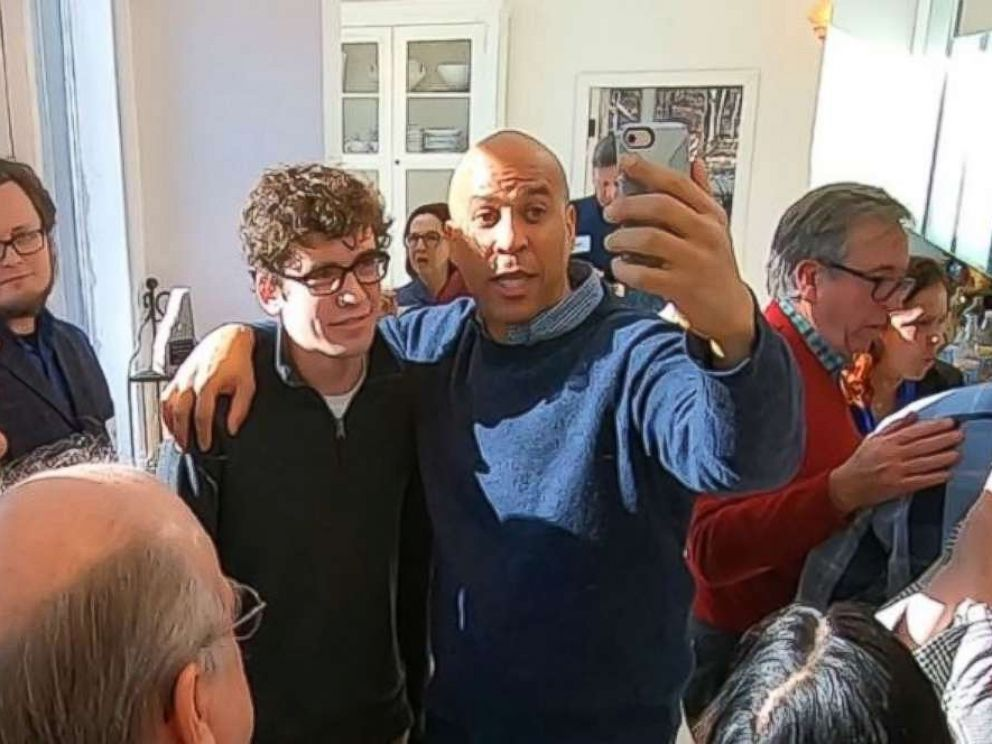 PHOTO: Sen. Cory Booker, D-N.J., poses for a photo at a house party in Nashua, N.H., as he tested the waters for a presidential run on Saturday, Dec. 8, 2018.