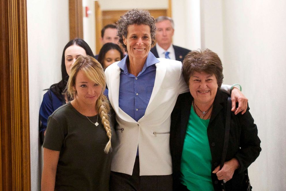 PHOTO: Bill Cosby accuser Andrea Constand, center, and supporters embrace after Cosby was found guilty in his sexual assault retrial, April, 26, 2018, at the Montgomery County Courthouse in Norristown, Pa.