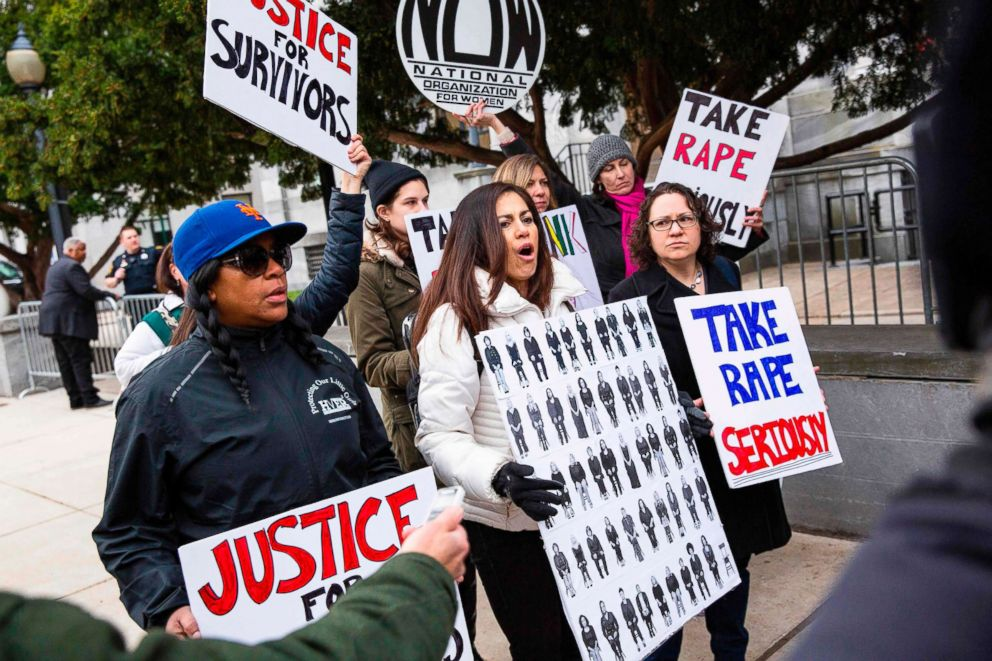 PHOTO: Protesters shout as Bill Cosby arrives for the first day of his second trial for sexual assault at the Montgomery County Courthouse in Norristown, Pa., April 9, 2018.