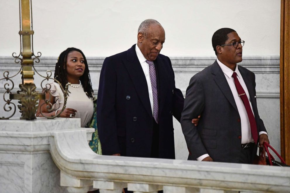 PHOTO: Bill Cosby, center, leaves with publicist Ebonee Benson, left, and spokesperson Andrew Wyatt for the day from his sexual assault trial at the Montgomery County Courthouse, April 18, 2018, in Norristown, Pa.