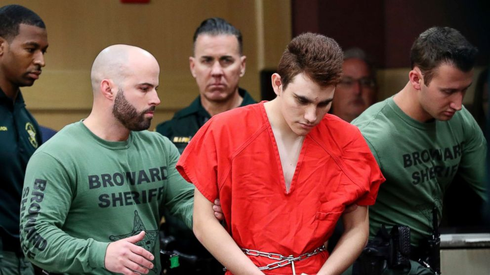Nikolas Cruz is lead into the courtroom before being arraigned at the Broward County Courthouse in  Fort Lauderdale, Fla., March 14, 2018.