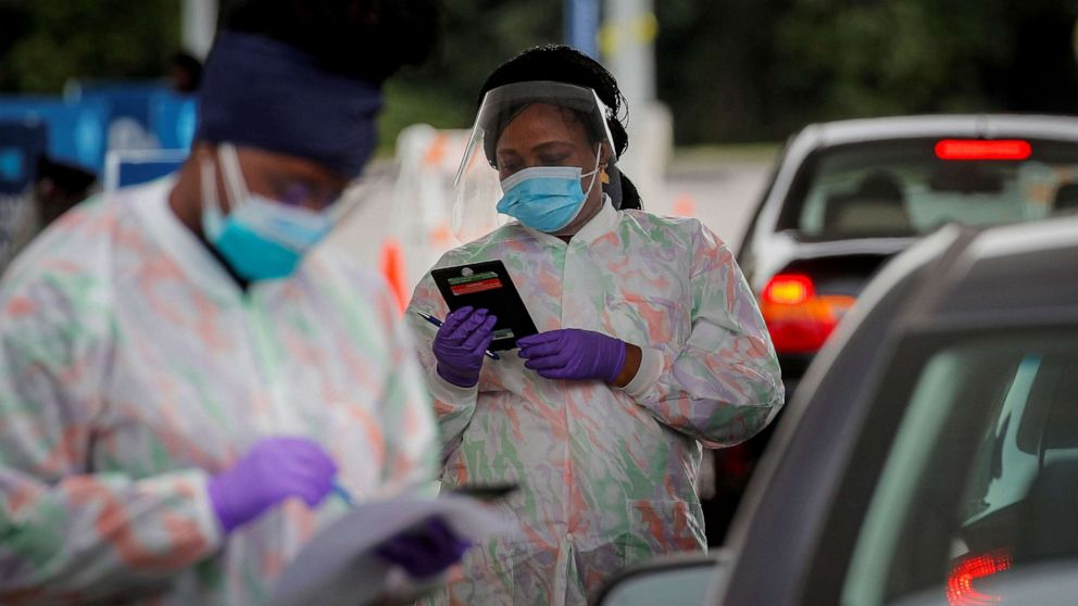 PHOTO: Medical technicians work at a drive-through coronavirus disease (COVID-19) testing facility at the Regeneron Pharmaceuticals company's Westchester campus in Tarrytown, New York, Sept. 17, 2020.