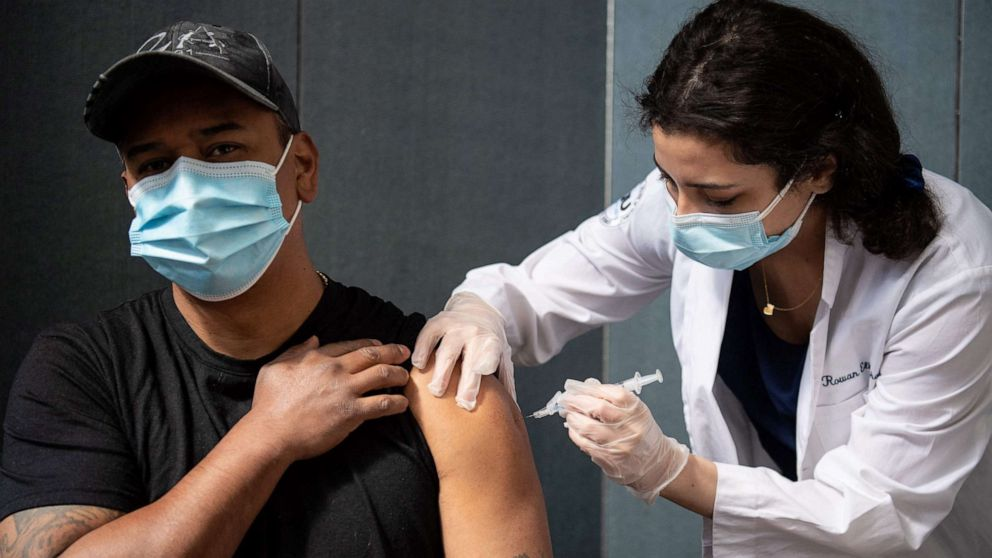 PHOTO: Javier Morena receives his first dose of the Moderna Covid-19 vaccine at the Jewish Community Center, a pop up vaccine clinic, April 16, 2021, in Staten Island, New York.