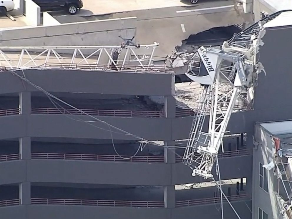 Crane collapses in downtown Dallas, at least two people injured