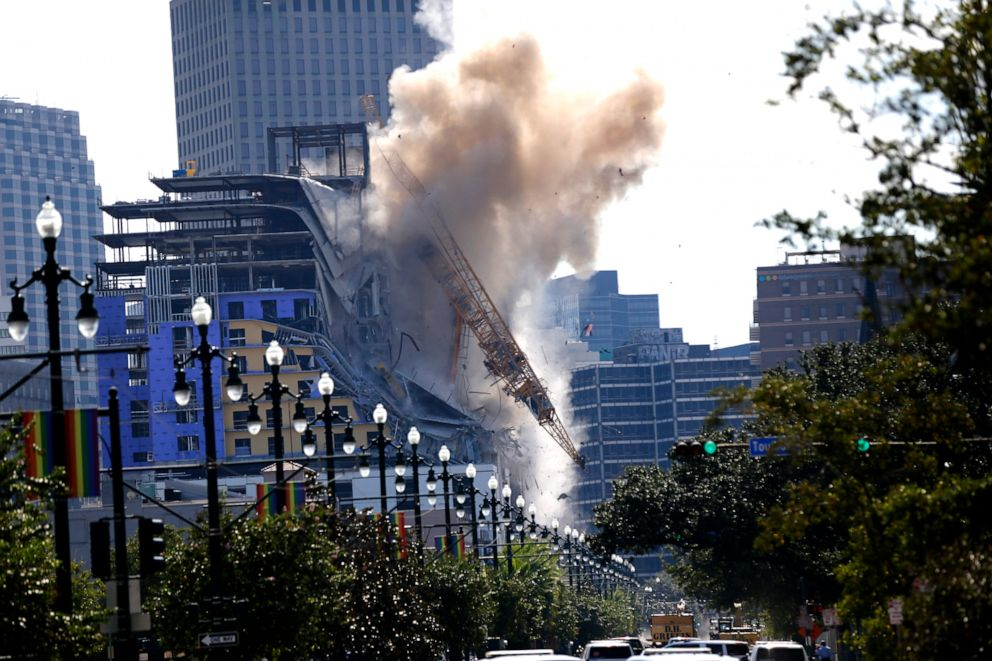 PHOTO: Two large cranes from the Hard Rock Hotel construction collapse come crashing down after being detonated for implosion in New Orleans, Oct. 20, 2019.